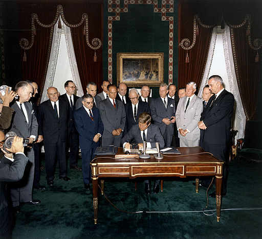 President John F. Kennedy signing the 1963 Limited Test Ban Treaty